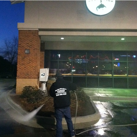 Night time pressure washing of restaurant parking lot in Wilmington, NC